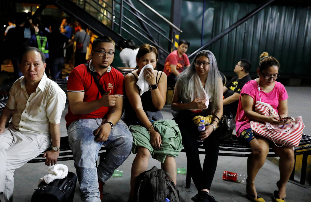 Tourists are pictured after being evacuated from a Resorts World building in Pasay City, Metro Manila, Philippines June 2, 2017. (Erik De Castro/Reuters)