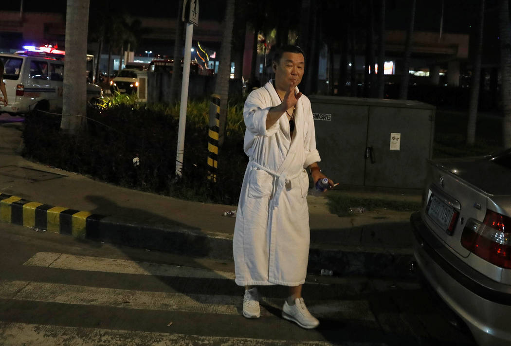 A tourist wearing a bathrobe gestures after he was evacuated from the Resorts World Manila after gunshots and explosions were heard in Pasay City, Metro Manila, Philippines June 2, 2017. (Erik De  ...