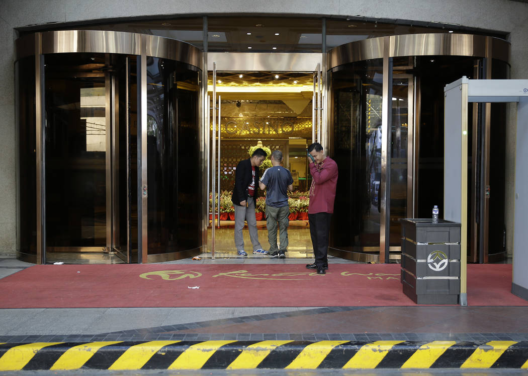 Security inspects a man at the entrance of the hotel at the Resorts World Manila complex, Friday, June 2, 2017, in Manila, Philippines. A gunman stormed a mall-casino complex in the Philippines, t ...