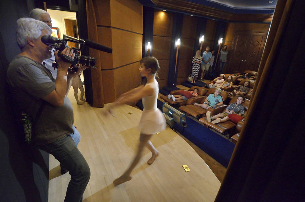 Director of photography Don Starnes films actress Grace O'Shaughnessy on the stage of a home studio during the making of a video to be used as a sales tool for the luxury home in the MacDon ...