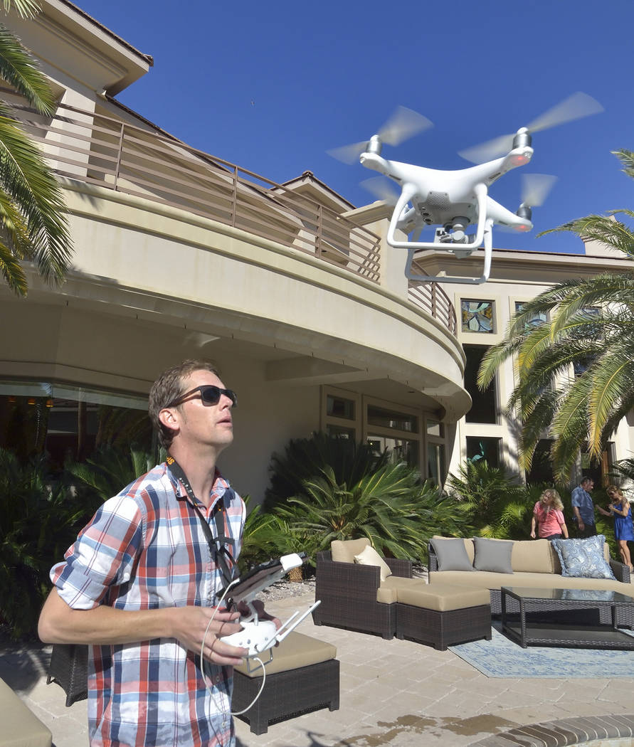 Bill Clary, owner of Got Aerial, pilots a drone during the making of a video to be used as a sales tool for a luxury home in the MacDonald Ranch community in Henderson on Saturday, May 13, 2017. ( ...