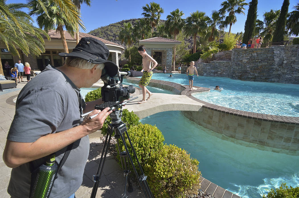 Director of photography Don Starnes is shown during the making of a video to be used as a sales tool for a luxury home in the MacDonald Ranch community in Henderson on Saturday, May 13, 2017. (Bil ...
