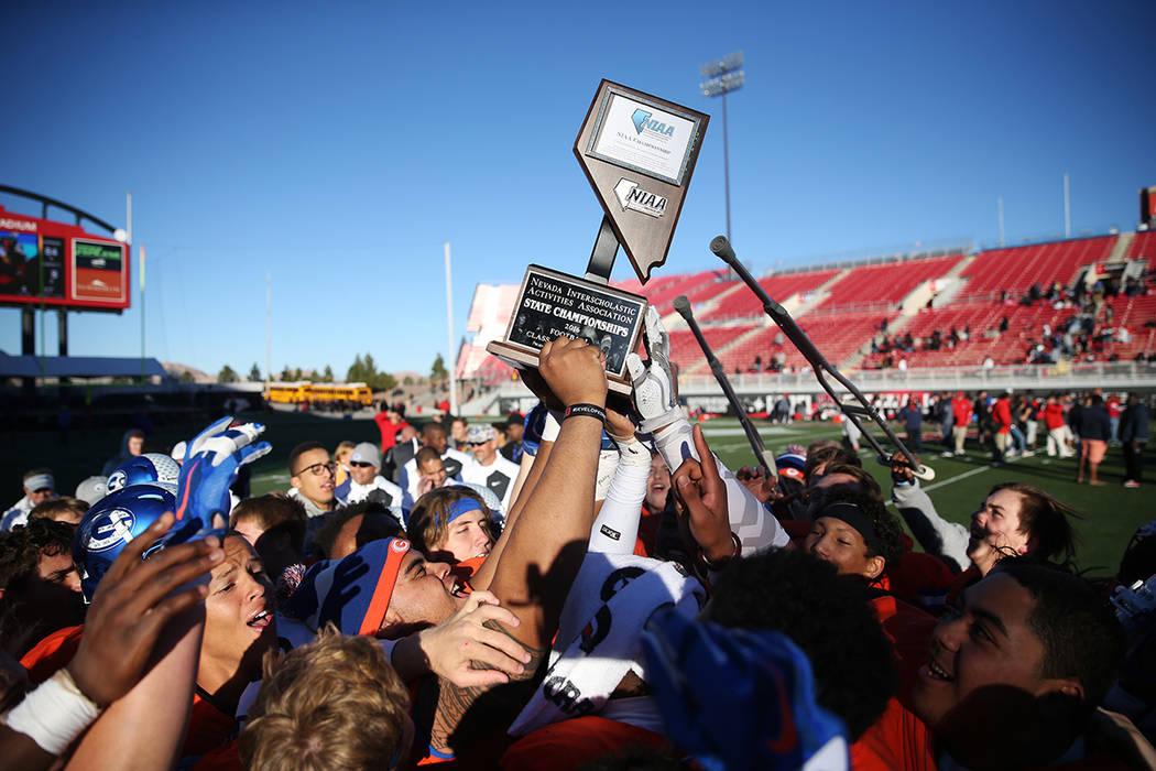 Bishop Gorman celebrate their win against Liberty in the Class 4A state football championship game at Sam Boyd Stadium on Saturday, Dec. 3, 2016, in Las Vegas. Bishop Gorman won 84-8. Erik Verduzc ...