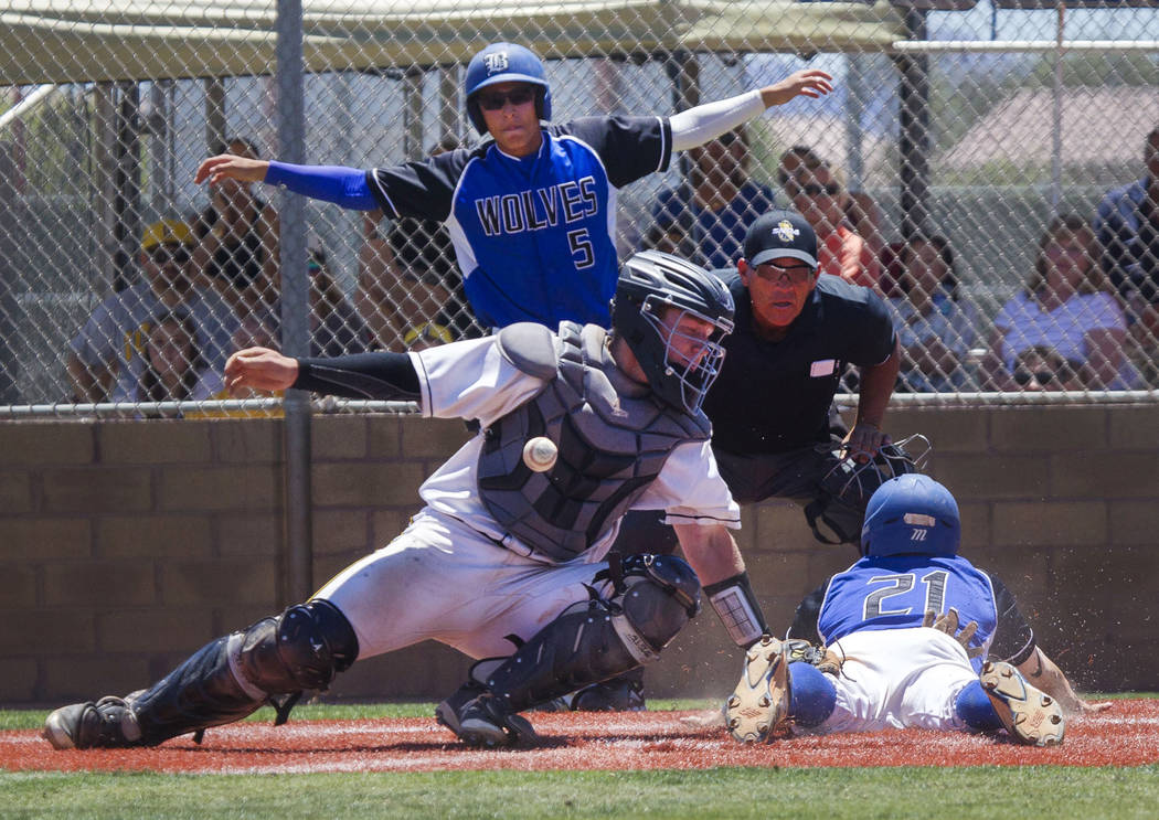 Basic's Paul Myro IV, right, slides safely into home plate against Galena in the NIAA Class 4A State Championship baseball game at Las Vegas High School in Las Vegas on Saturday, May 20, 2017. Ric ...