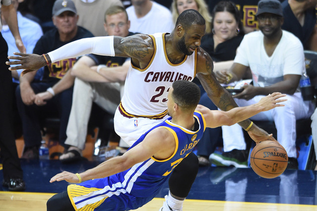 e0cf8d47a6e Cleveland Cavaliers forward LeBron James (23) dribbles the ball past Golden  State Warriors guard