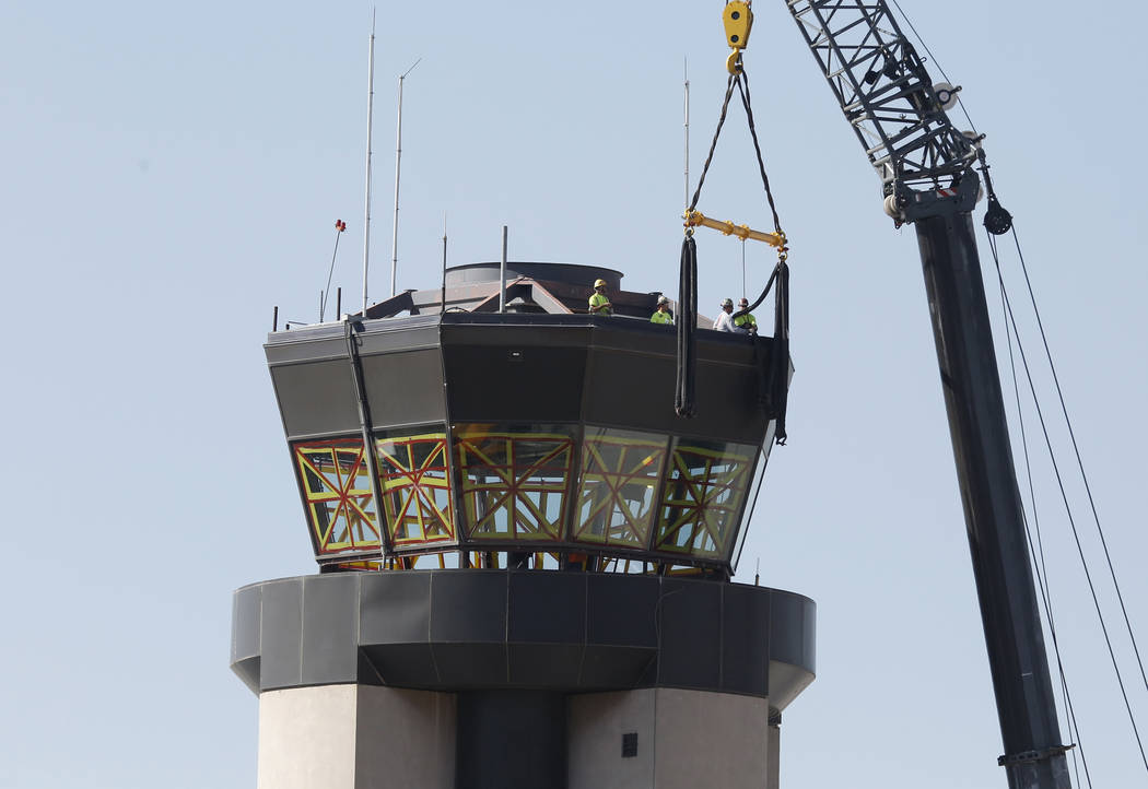 Workers prepare to lift a 525-square-foot cab from the top of the former air traffic tower at McCarran International Airport on Thursday, June 1, 2017, in Las Vegas. Bizuayehu Tesfaye Las Vegas Re ...