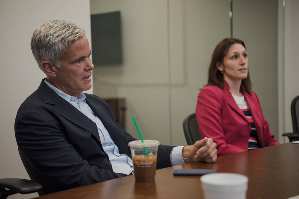 Doug Petno, CEO of JPMorgan Chase's Commercial Banking, sitting left of JPMorgan Chase Market Executive Megan Ackaert, discusses the inaugural office opening on Wednesday, June 7, 2017 in Las Vega ...