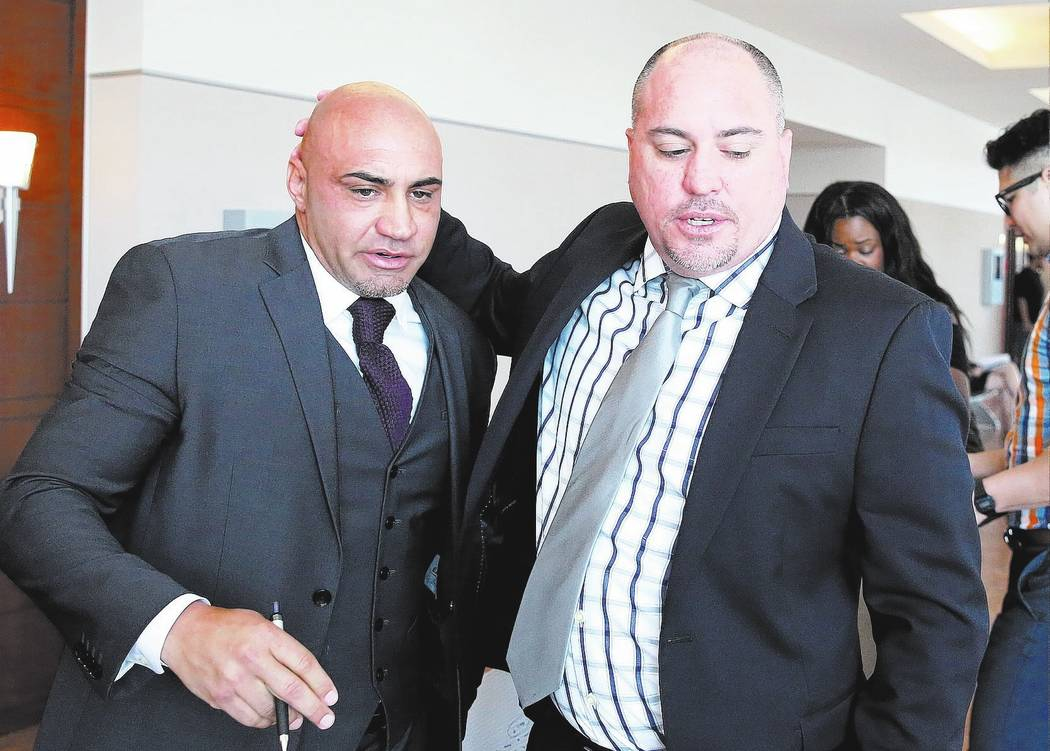 Kenny Sanchez, Bishop Gorman High School football head coach, left, leaves the courtroom with his brother Tony Sanchez, UNLV football head coach.  Bizuayehu Tesfaye Las Vegas Review-Journal @bizut ...