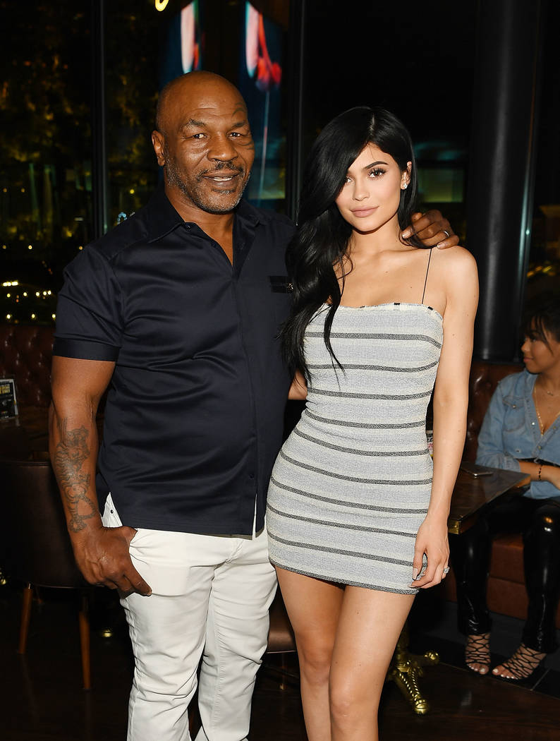 Kylie Jenner, here with Mike Tyson, attends Sugar Factory American Brasserie Fashion Show's grand opening Saturday, April 22, 2017, in Las Vegas. (Denise Truscello/WireImage)