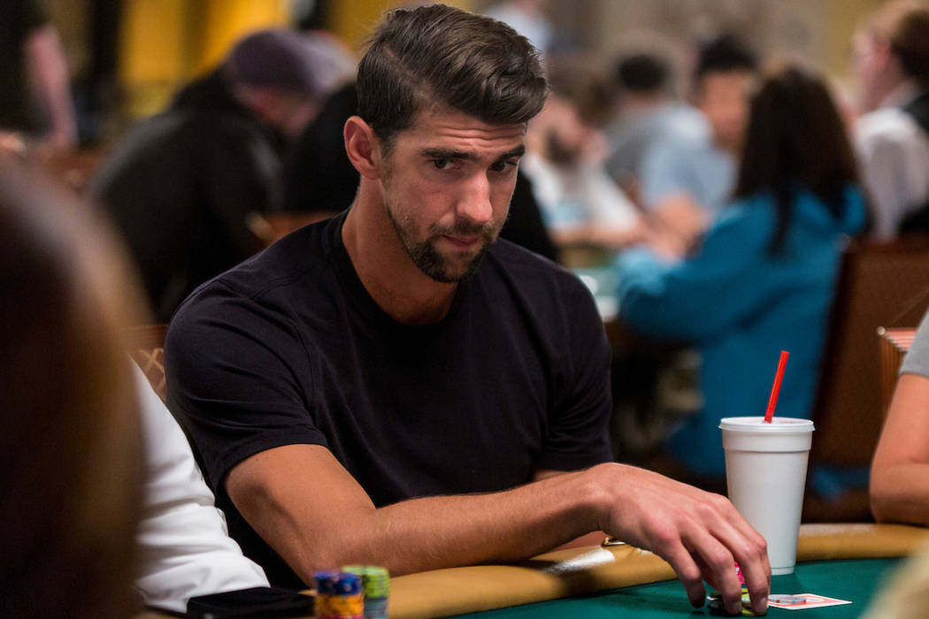 Olympic champion swimmer Michael Phelps plays poker during a tag-team event in the opening of The World Series of Poker at The Rio on Wednesday, May 31, 2017, in Las Vegas. (Melissa Haereiti)