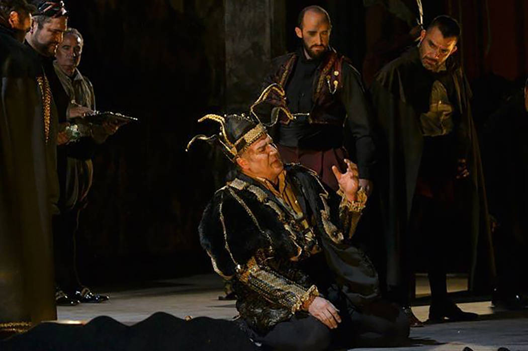 """Michael Chioldi (seated, center) as """"Rigoletto's"""" title character. Opera Las Vegas"""