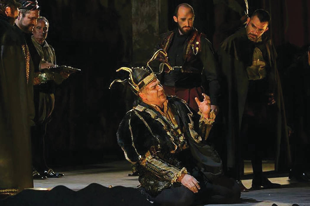 """Opera Las Vegas Michael Chioldi (seated, center) as """"Rigoletto's"""" title character."""