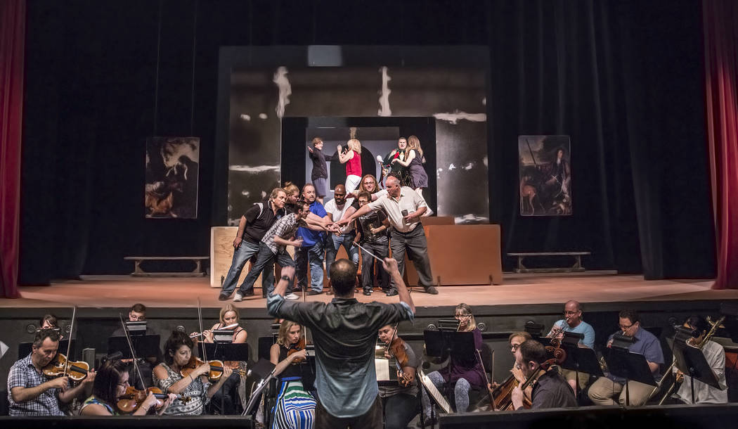 "Conductor Gregory Buchalter, middle/bottom, directs the orchestra during rehearsal for ""Rigoletto"" at Judy Bayley Theatre on Monday, June 5, 2017, at UNLV, in Las Vegas. Benjamin Hager Las Vegas R ..."