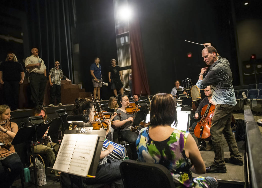 "Conductor Gregory Buchalter, right, directs the orchestra during rehearsal for ""Rigoletto"" at Judy Bayley Theatre on Monday, June 5, 2017, at UNLV, in Las Vegas. Benjamin Hager L ..."