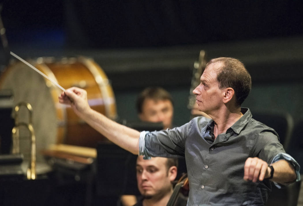 """Conductor Gregory Buchalter directs the orchestra during rehearsal for """"Rigoletto"""" at Judy Bayley Theatre on Monday, June 5, 2017, at UNLV, in Las Vegas. Benjamin Hager Las Vegas ..."""