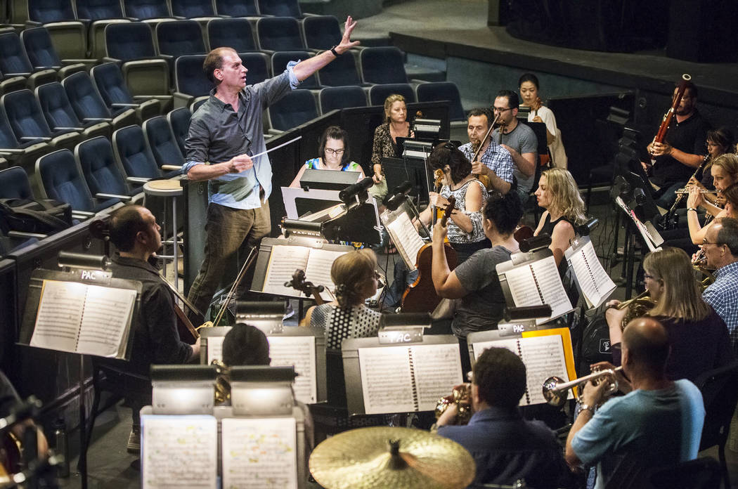 "Conductor Gregory Buchalter, left, directs the orchestra during rehearsal for ""Rigoletto"" at Judy Bayley Theatre on Monday, June 5, 2017, at UNLV, in Las Vegas. Benjamin Hager La ..."