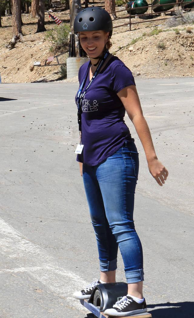 Las Vegas Review-Journal reporter Gabriella Benavidez tries out a Onewheel, an electrical self-balancing skateboard at Lee Canyon, Friday, May 26, 2017. Ben Gotz Las Vegas Review-Journal @BenSGotz