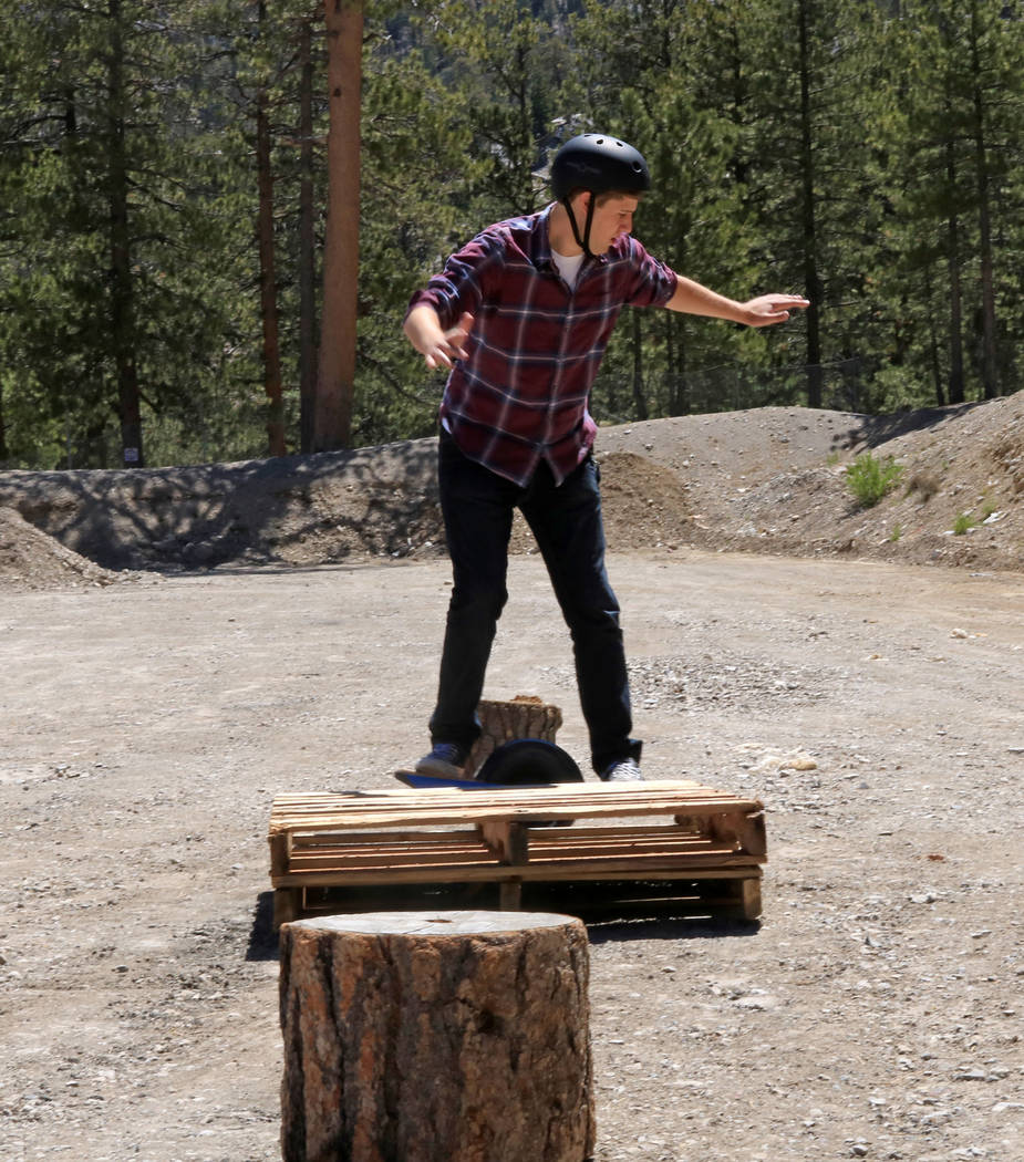 Las Vegas Review-Journal reporter Ben Gotz makes his way through an obstacle course at Lee Canyon while trying out a Onewheel, an electrical self-balancing skateboard, Friday, May 26, 2017.  Gabri ...