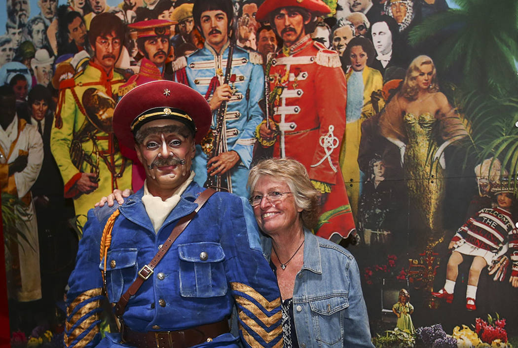 "Vladimir Sosnine, who plays ""Sgt. Pepper"" in Cirque du Soleil's ""Love,"" poses for a photo with Nancy Kimbrough of Boulder, Colo. following a performance by a display commemorating the 50th anniver ..."