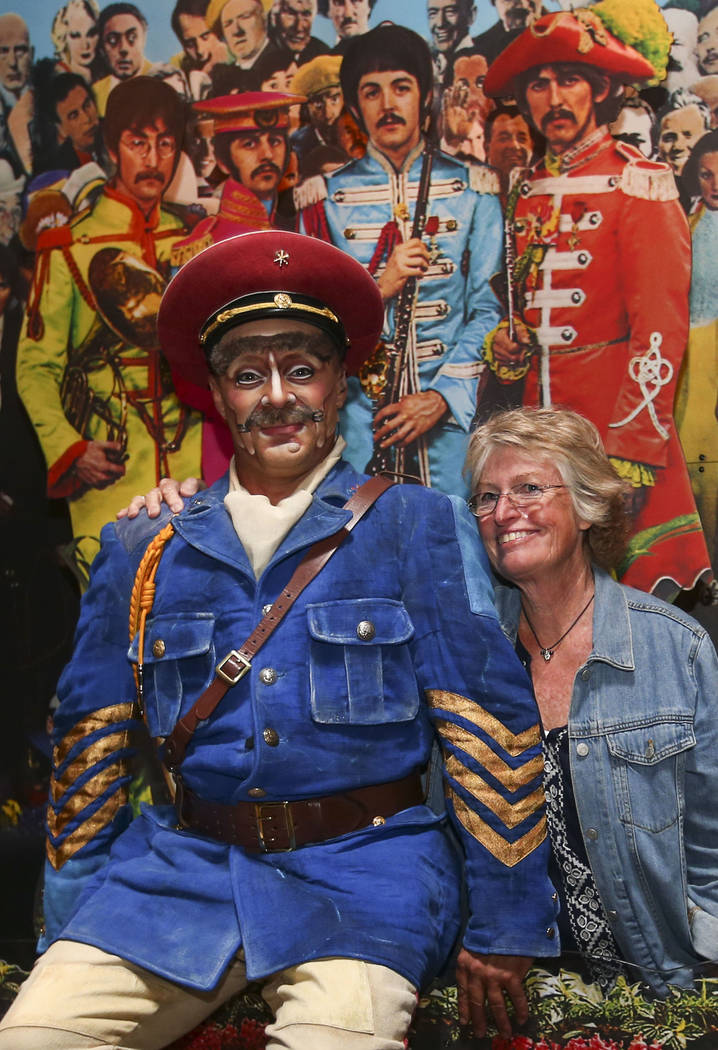 "Vladimir Sosnine, who plays ""Sgt. Pepper"" in Cirque du Soleil's ""The Beatles LOVE,"" poses for a photo with Nancy Kimbrough of Boulder, Colo. following a performance by a display commemorating the  ..."