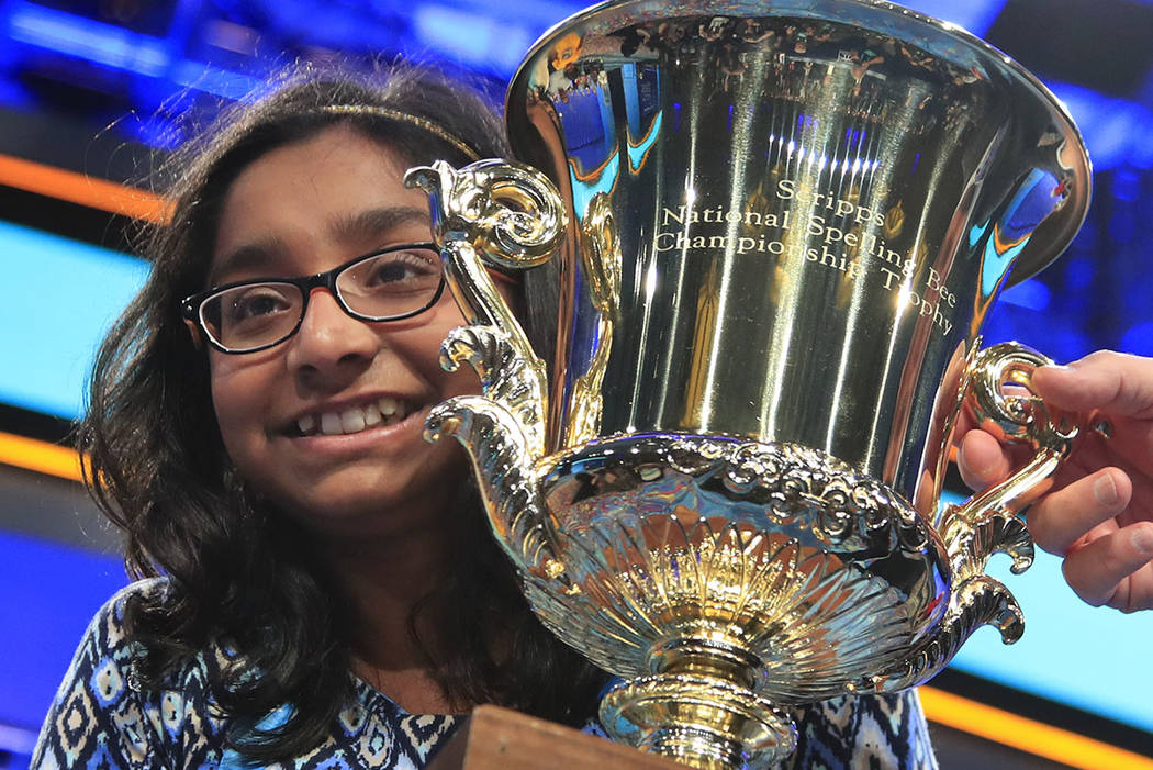 Ananya Vinay, 12, from Fresno, Calif., holds the trophy after being declared the winner of the 90th Scripps National Spelling Bee, in Oxon Hill, Md., Thursday, June 1, 2017. (AP Photo/Manuel Balce ...