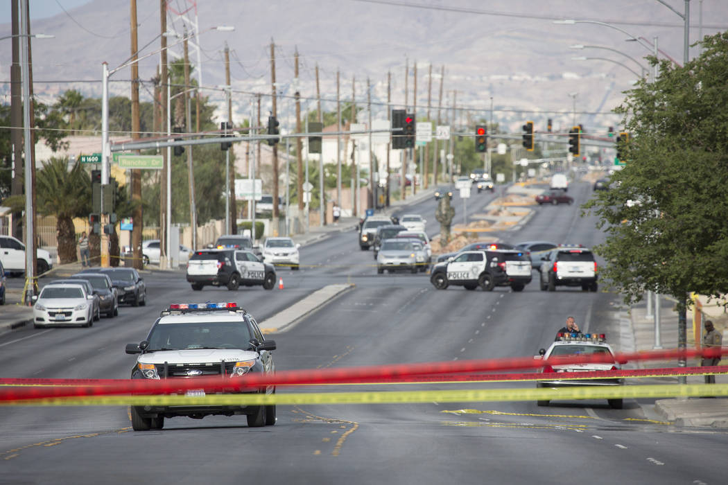 Metro vehicles at the scene of an officer-involved shooting near Silver Lake and Vegas drives on Wednesday, May 31, 2017 in Las Vegas. No one was injured by the gunfire exchange, Metro said. Bridg ...