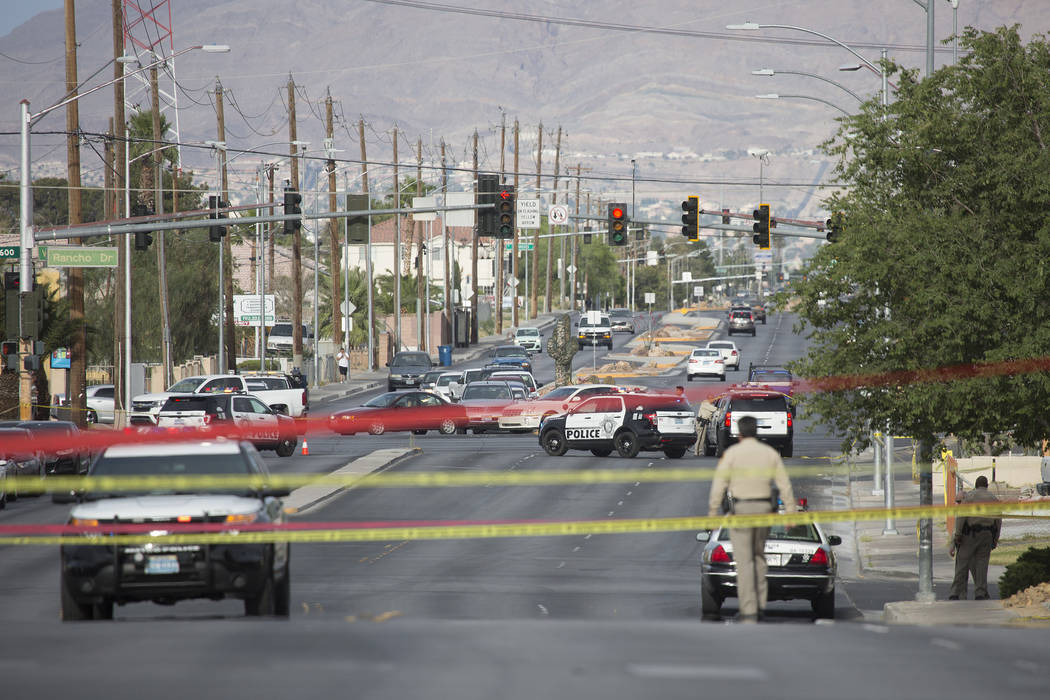 Officers at the scene of an officer-involved shooting near Silver Lake and Vegas drives on Wednesday, May 31, 2017 in Las Vegas. No one was injured by the gunfire exchange, Metro said. Bridget Ben ...
