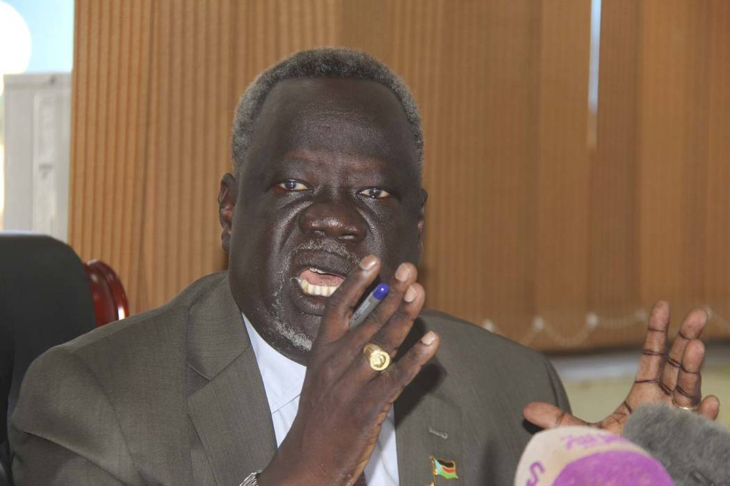 The  South African Minister of Health Dr Riek Gai Kok speaks  uring a newss conference in Juba, South Sudan Friday, June 2, 2017. South Sudan's government says 15 young children have died in a bot ...