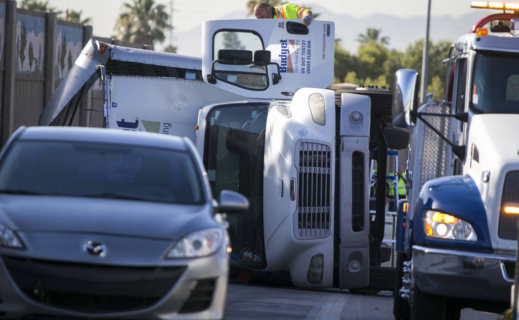 The scene of a rollover crash involving a Budget rental truck on U.S. Route 95 North near East Charleston Boulevard on Friday, June 2, 2017. Richard Brian Las Vegas Review-Journal @vegasphotograph