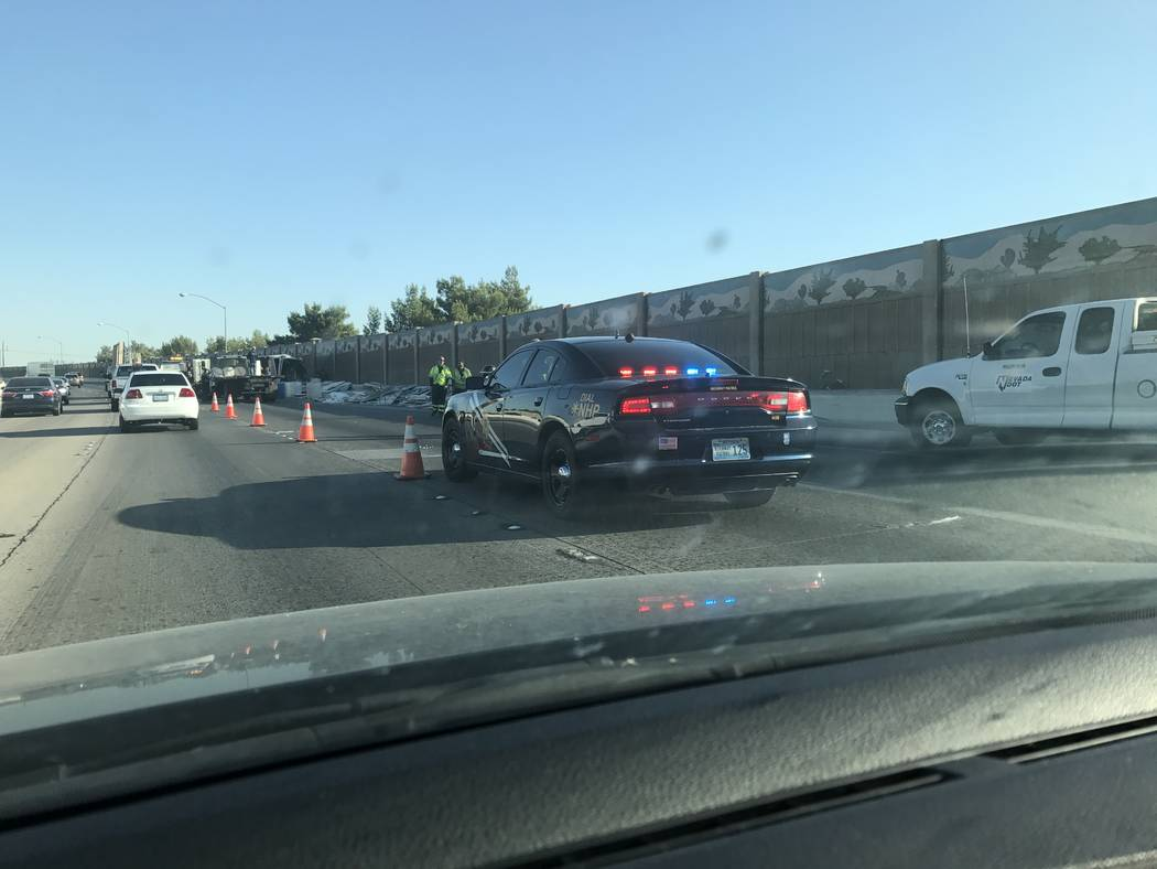 Crews are working to clear debris on the shoulder of northbound US 95 near East Charleston Boulevard. (Elaine Wilson/Las Vegas Review-Journal)