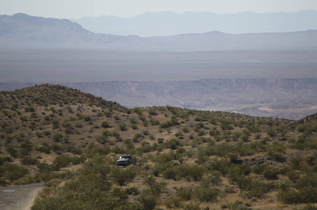 A truck drives through the Gold Butte National Monument south of Bunkerville on Friday, June 2, 2017. Chase Stevens Las Vegas Review-Journal @csstevensphoto