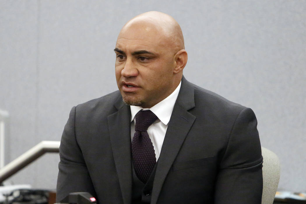 Kenny Sanchez, Bishop Gorman's head football coach charged with domestic violence against his ex-girlfriend, takes the witness stand at the Regional Justice Center on Tuesday, May 30, 2017, in Las ...