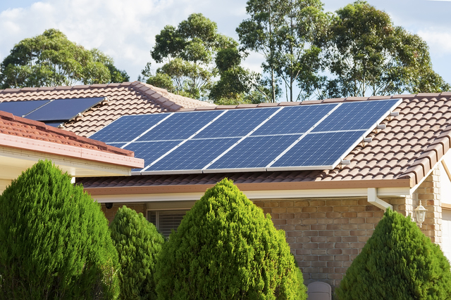 Photovoltaic panels like the ones on this home's rooftop generate electric power by using solar cells to convert energy from the sun. (Thinkstock)