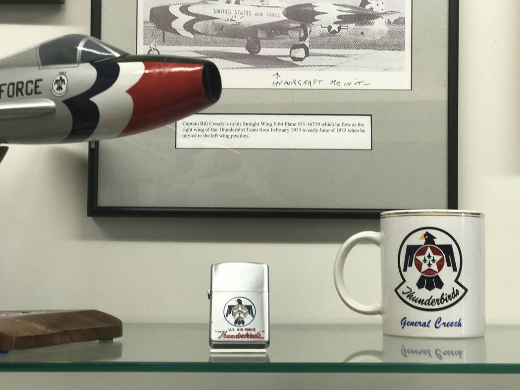 "Gen. Wilbur ""Bill"" Creech's Thunderbirds lighter and coffee mug are among the items displayed, June 1, 2017, at the base in Indian Springs, Nevada that was named for the general  ..."