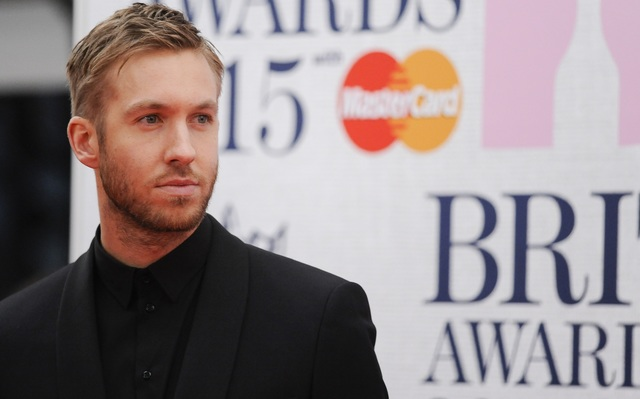 Calvin Harris arrives at The Brit Awards at The O2 on Wednesday, Feb. 25, 2015, in London, England. (Euan Cherry/WENN.com)