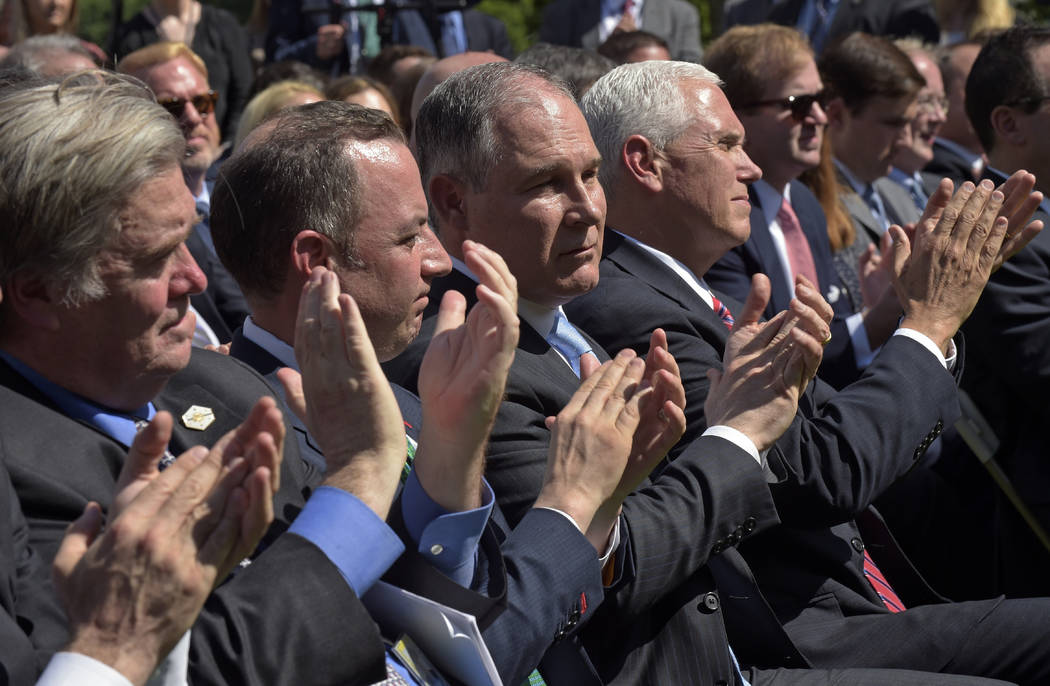 Administration officials, from left, White House chief strategist Steve Bannon, Chief of Staff Reince Priebus, Environmental Protection Agency Administrator Scott Pruitt, and Vice President Mike P ...