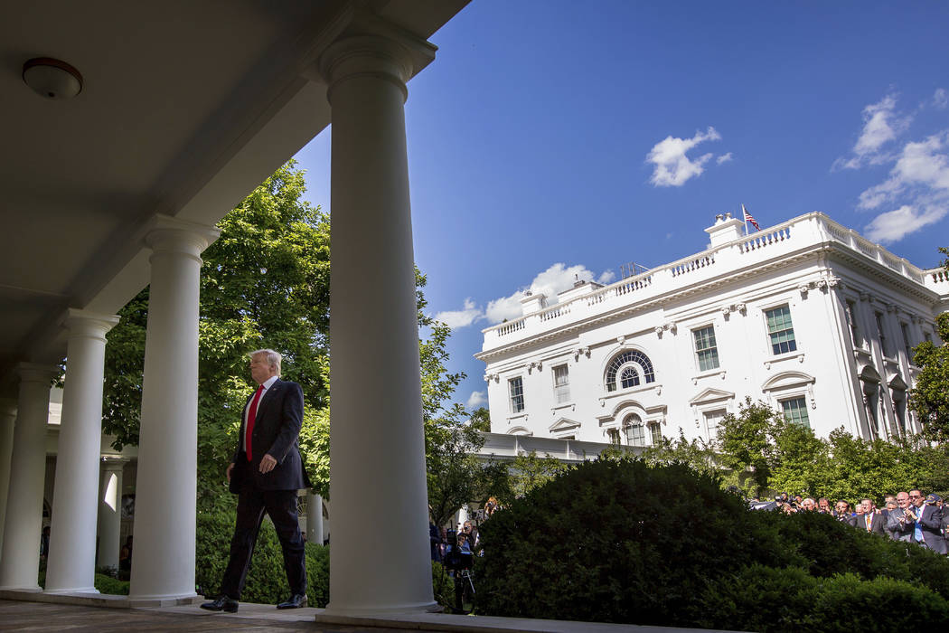 President Donald Trump walks to the Oval Office of the White House in Washington, Thursday, June 1, 2017, after speaking in the Rose Garden about the US role in the Paris climate change accord. (A ...
