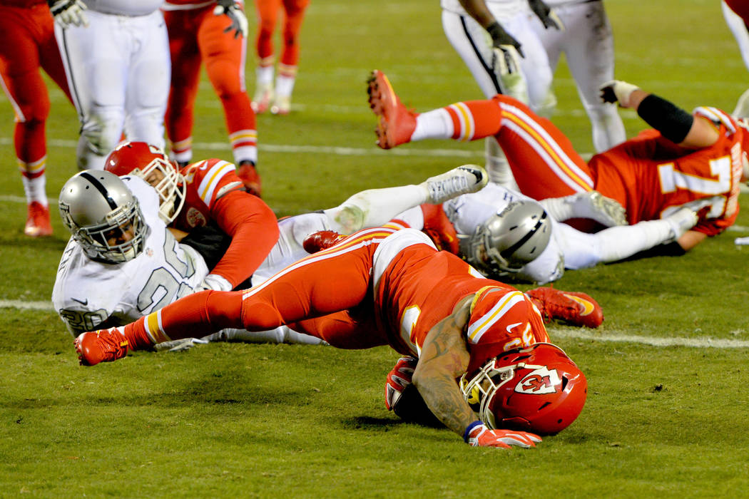 Dec 8, 2016; Kansas City, MO, USA; Kansas City Chiefs running back Charcandrick West (35) runs for a touchdown as Oakland Raiders strong safety Nate Allen (20) misses the tackle during the first h ...