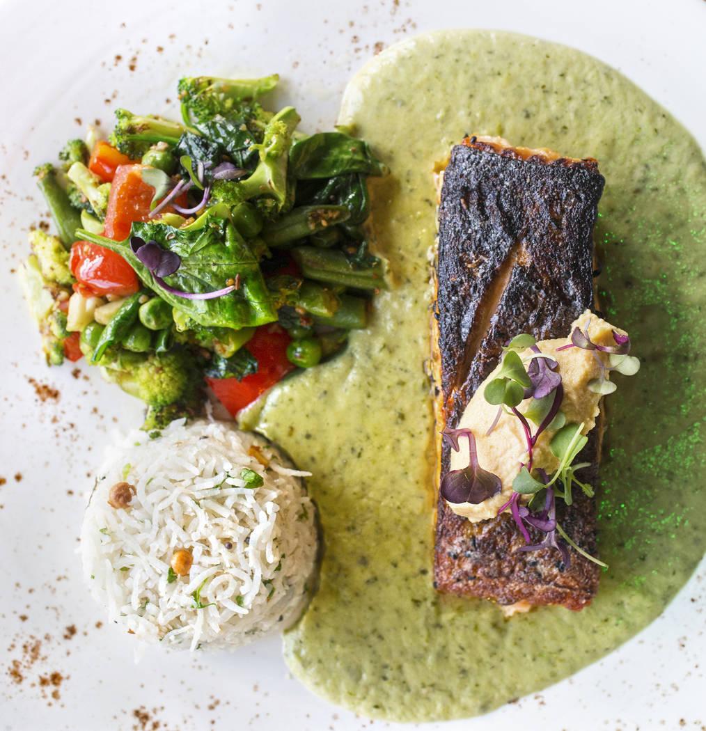 Pan seared North Atlantic salmon with nilgiri korma sauce and coconut rice on Thursday, June 8, 2017, at Turmeric, in Las Vegas. Benjamin Hager Las Vegas Review-Journal @benjaminhphoto