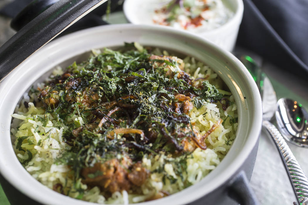 Biryani rice layered with lamb, spices, saffron, brown onions and raita on Thursday, June 8, 2017, at Turmeric, in Las Vegas. Benjamin Hager Las Vegas Review-Journal @benjaminhphoto