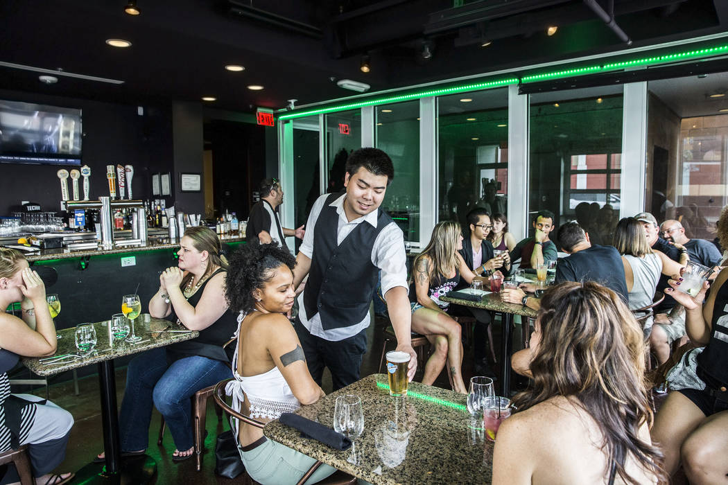 Bartender Greg Tanonaka, middle, serves beers to guests in the dinning room at Turmeric on Saturday, June 10, 2017, in Las Vegas. Benjamin Hager Las Vegas Review-Journal @benjaminhphoto