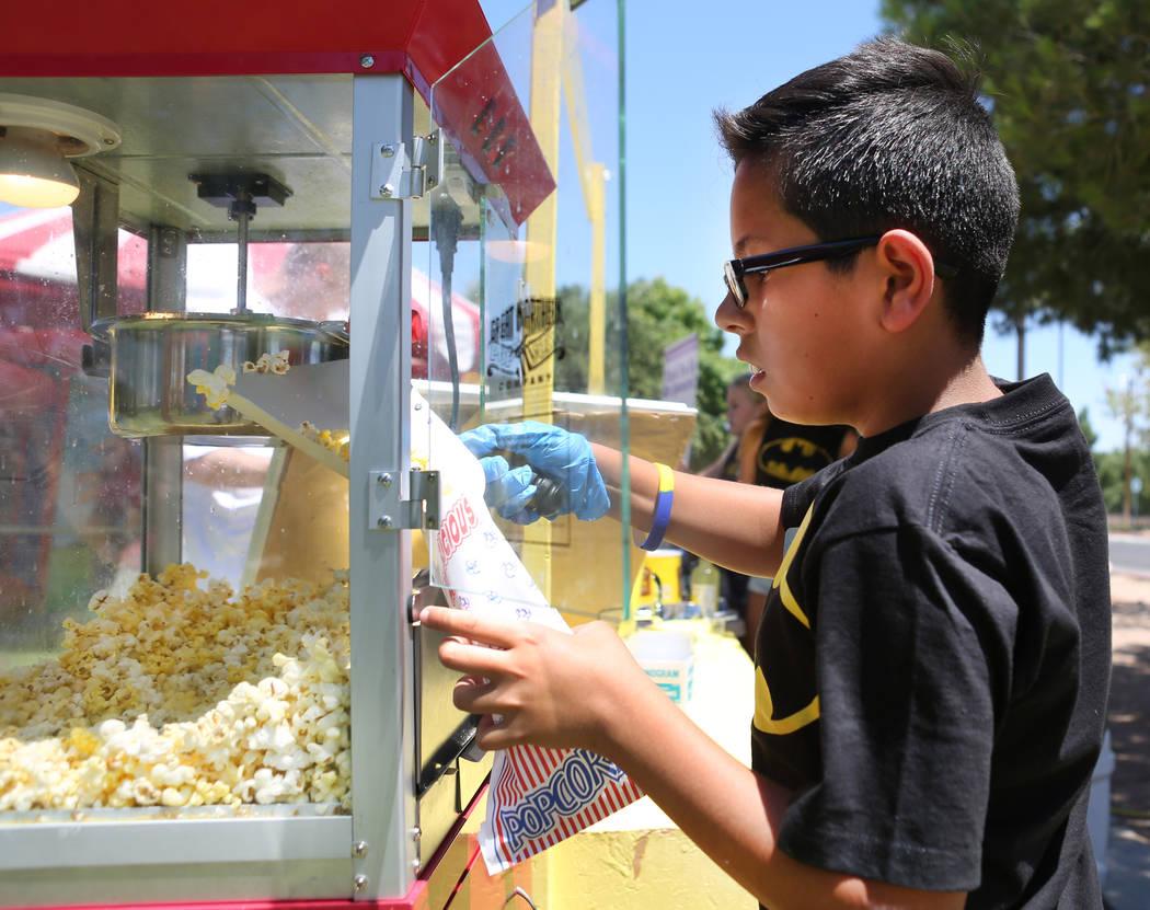 Tommy Ramos, 11, prepares popcorn during a fundraiser for Alex's Lemonade Stand Foundation, a national childhood cancer foundation, at Sunset Park in Las Vegas, Sunday, June 4, 2017. Elizabeth Bru ...