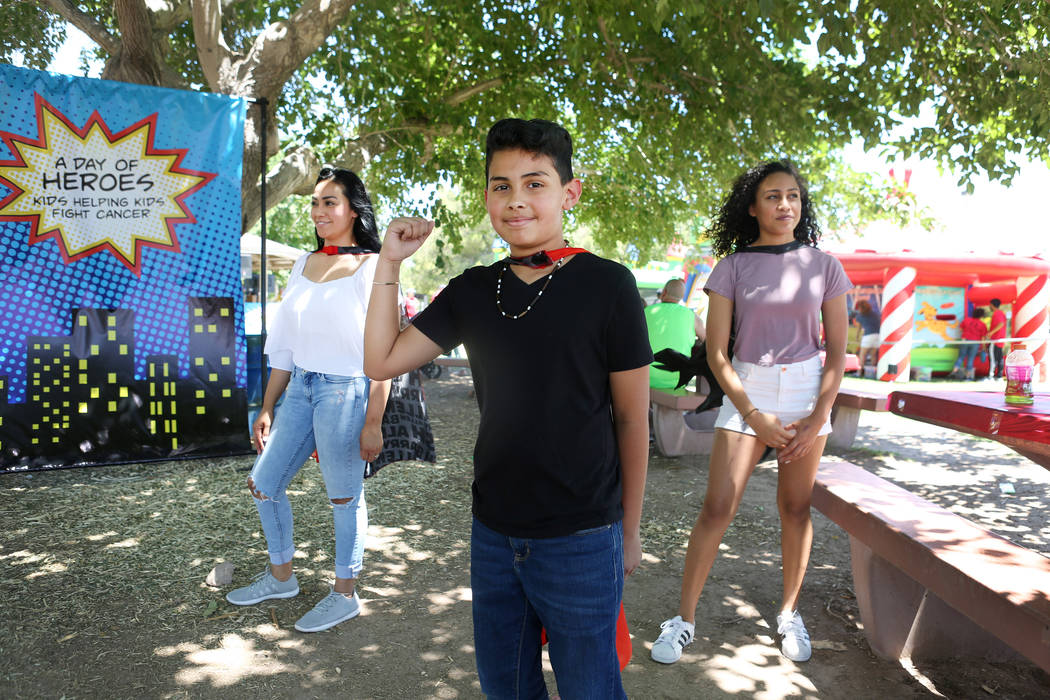 Francesco Mancia, 10, center, Nancy Marone, left, and  Victoria Marone, 14, wear capes just like superheroes during a fundraiser for Alex's Lemonade Stand Foundation, a national childhood cancer f ...