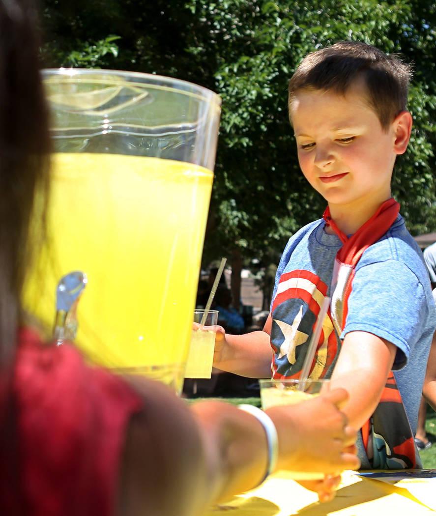 Adam Kemper, 9, works during a fundraiser for Alex's Lemonade Stand Foundation, a national childhood cancer foundation, at Sunset Park in Las Vegas, Sunday, June 4, 2017. (Elizabeth Brumley/Las Ve ...