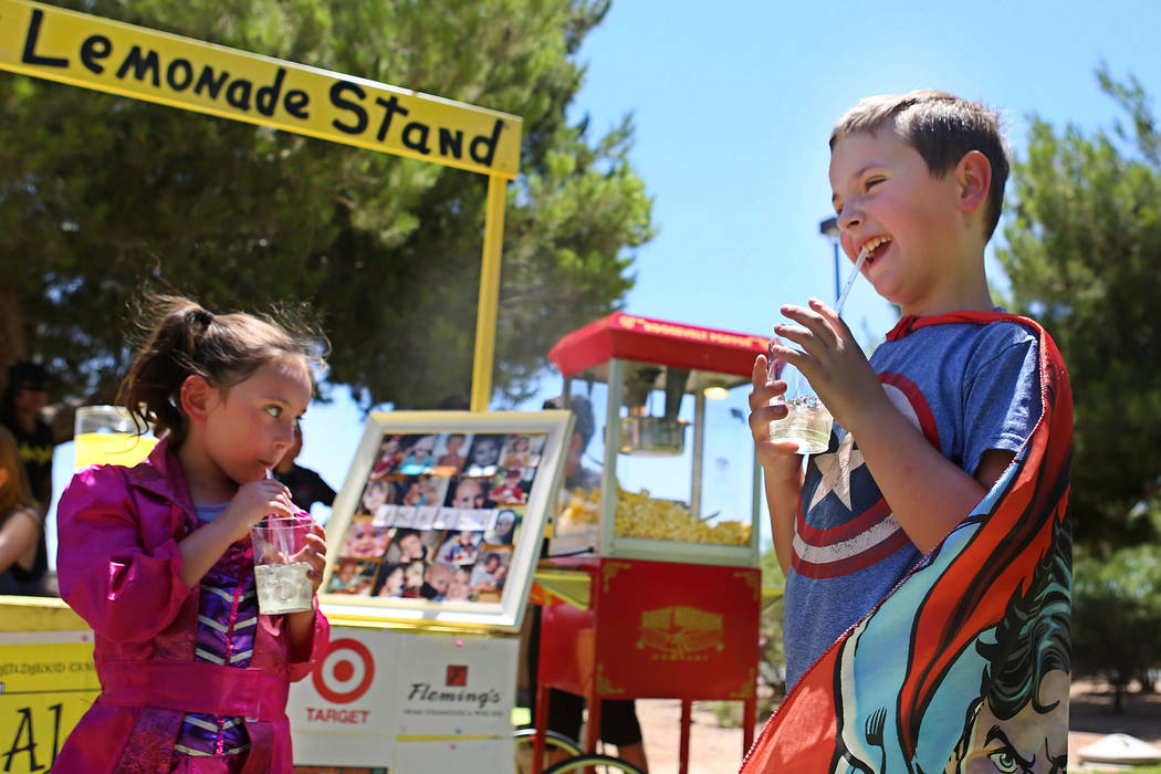 Zoey Blascovich, 5, left, and Adam Kemper, 9,  drink their lemonade during a fundraiser for Alex's Lemonade Stand Foundation, a national childhood cancer foundation, at Sunset Park in Las Vegas, S ...
