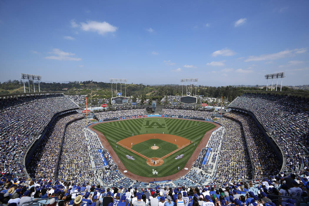 Dodger Stadium is seen during the first inning of an opening day baseball game between the Los Angeles Dodgers and the San Diego Padres, Monday, April 3, 2017, in Los Angeles. (AP Photo/Ryan Kang)