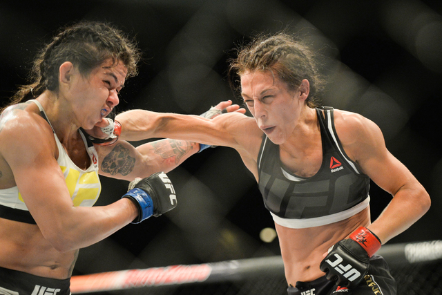 Joanna Jedrzejczyk, right, lands a blow on Claudia Gadelha in The Ultimate Fighter 23 Finale at the MGM Grand Garden Arena in Las Vegas on Friday, July 8, 2016. Jedrzejczyk won by unanimous decisi ...
