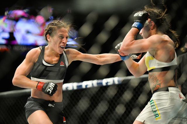 Joanna Jedrzejczyk, left, lands a blow on Claudia Gadelha in The Ultimate Fighter 23 Finale at the MGM Grand Garden Arena in Las Vegas on Friday, July 8, 2016. Jedrzejczyk won by unanimous decisio ...