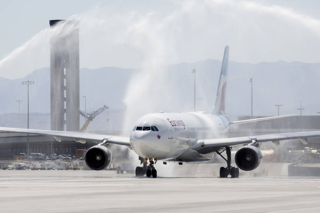After it lands, McCarran International Airport welcomes the first Eurowings flight that few direct from Cologne, Germany with a water arch on Friday, June 2, 2017 in Las Vegas.  Bridget Bennett La ...