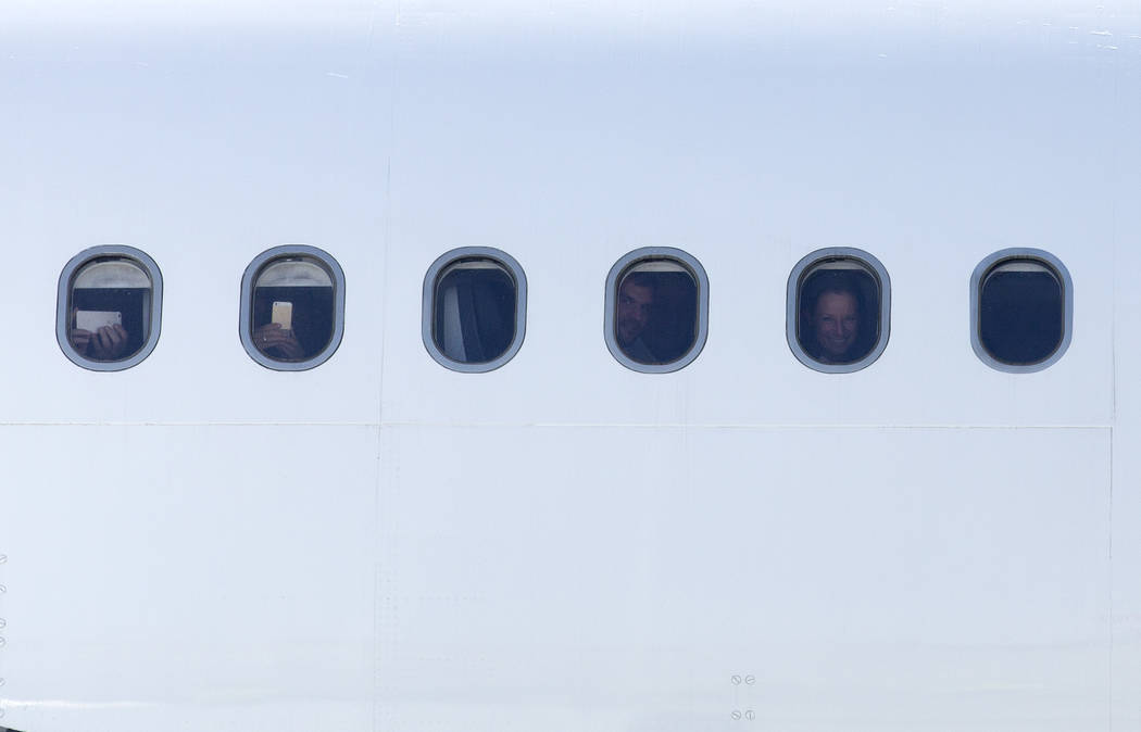 Passengers on the first Eurowings flight, that few direct from Cologne, Germany, look out their windows at McCarran International Airport on Friday, June 2, 2017 in Las Vegas.  Bridget Bennett Las ...